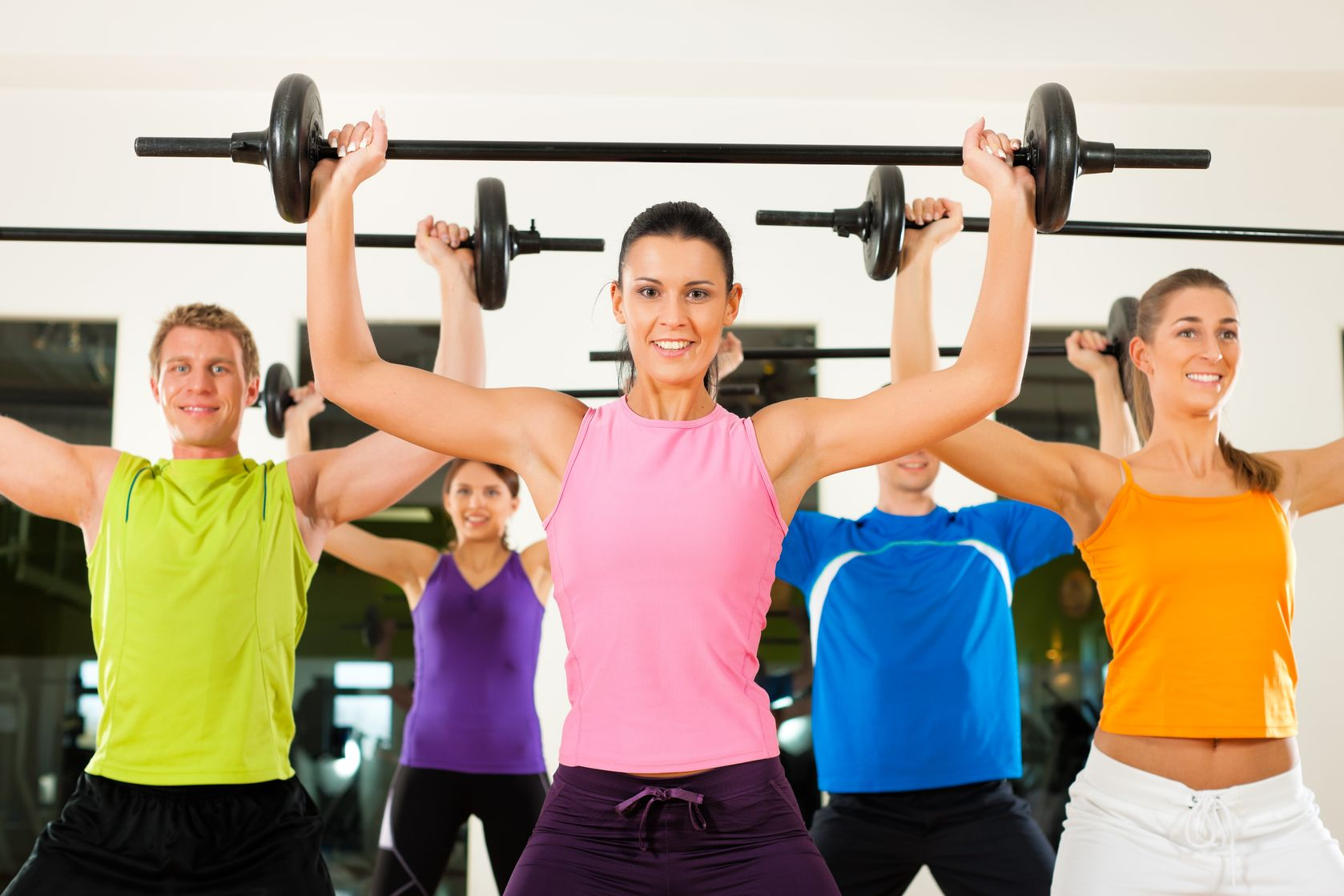 11840891 - group of five people exercising using barbells in gym or fitness club to gain strength and fitness